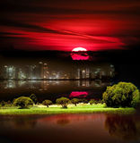 Fantasy city under red after-storm skylight. View of Fantasy city under red after-storm skylight Royalty Free Stock Images