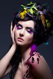 Fantasy. Colorful Feathers - Bright Makeup Stock Photography
