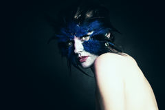 Fantasy concept. Woman with Art Makeup. Fantasy Blue Bird Stock Photo