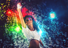 Fantasy Dance Party. Young woman performing dance at fantasy party with colorful disco lights stock images