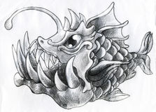 Fantasy deep water fish - pencil sketch. Hand drawn pencil sketch of a fantasy deep water fish with huge teeth and a light bulb on the head Royalty Free Stock Photography