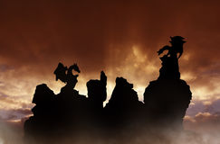 Fantasy dragons. Dragons silhouette over rocks at sunrise Stock Photography