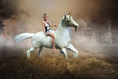 Fantasy Elf, Fairy, Unicorn, Nature, Taj Mahal. Fantasy landscape with a fairy elf and a wildlife animal Unicorn horse. The surreal scene has the Taj Mahal in