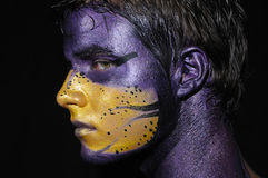 Fantasy face. Portrait of young boy with artistic bodypaint drawing on face - isolated on black Stock Images
