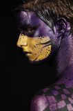 Fantasy face. Portrait of young model wearing artistic bodypaint drawing Stock Image