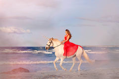 Fantasy fiction woman on unicorn royalty free stock photos