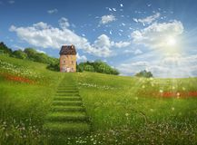 Fantasy field and house in a beautiful day Royalty Free Stock Photo