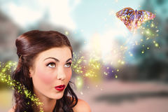 Fantasy fine art beauty. Fairy tale butterflies. Fine art beauty and fashion portrait of a fairy tale girl with amazing makeup watching magic butterflies spiral Royalty Free Stock Images