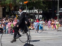 Fantasy floats ` British traditional costume riding on vintage high wheel bicycle ` perform in the 2018 Credit Union Christmas. ADELAIDE, SOUTH AUSTRALIA. - On royalty free stock image