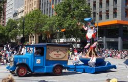 Fantasy floats ` Christmas Cake Maker ` perform in the 2018 Credit Union Christmas Pageant parade. royalty free stock photo