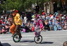 Fantasy floats ` Clowns on the one wheel bicycle ` perform in the 2018 Credit Union Christmas Pageant parade. ADELAIDE, SOUTH AUSTRALIA. - On November 10, 2018 stock image