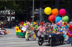Fantasy floats ` Colorful balloons with clowns on vintage cars ` perform in the 2018 Credit Union Christmas Pageant parade. ADELAIDE, SOUTH AUSTRALIA. - On stock photo