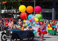 Fantasy floats ` Colorful balloons with clowns on vintage cars ` perform in the 2018 Credit Union Christmas Pageant parade. ADELAIDE, SOUTH AUSTRALIA. - On royalty free stock images