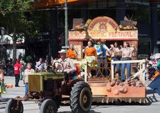 Fantasy floats ` Country rock music festival ` perform in the 2018 Credit Union Christmas Pageant parade. stock image