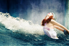 Fantasy flood. Fantasy scene of flood with helpless woman hold on column stock photography