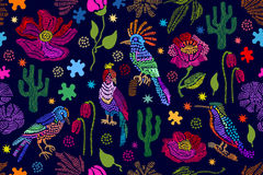 Fantasy floral embroidery. Seamless vector pattern with birds, plants and flowers. Stock Photos