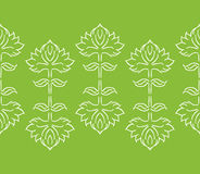 Fantasy floral seamless border or pattern with ethnic style hand drawn leaf elements, white on green Stock Images