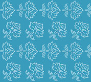 Fantasy floral seamless pattern with ethnic style hand drawn leaf elements, white on blue, vector illustration Royalty Free Stock Photo
