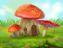 Fantasy fly agaric mushroom cottage on a colorful meadow Stock Photo