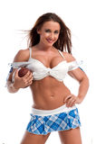 Fantasy Football. Well conditioned young woman ready to play fantasy football Stock Images