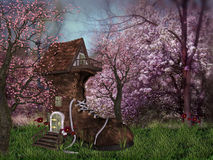 Fantasy Forest with shoe house. Cute little shoe house in the middle of a very cute forest with flowers through out Stock Images