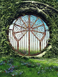 Fantasy gate in a garden. With spring flowers and vines Royalty Free Stock Photography