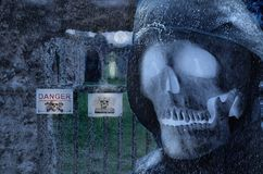 Fantasy gate in moonlight with skull and ghost stock image