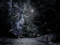 Fantasy girl with blue hair. In the magic forest Stock Photos