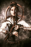 Fantasy girl. Portrait of a beautiful steampunk woman holding a gun over grunge background stock image