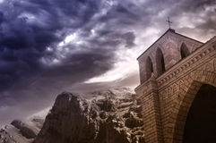 Fantasy gothic monastery. Gothic hermitage with mountains and dark sky Royalty Free Stock Images