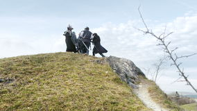 Fantasy Group Walking in Mountains stock video footage