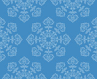 Fantasy hand drawn ethnic style white floral snowflake seamless pattern on blue, vector illustration Royalty Free Stock Image