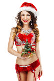 Fantasy. Happy Snow Maiden in Red Lingerie with Gift - Xmas Tree Royalty Free Stock Photos
