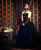 Fantasy heroine. Portrait of a beautiful steampunk woman over vintage background royalty free stock photography
