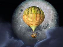 Fantasy hot air balloon in front of the moon Royalty Free Stock Image