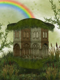 Fantasy house. With garden and rainbow Royalty Free Stock Photos