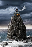 Fantasy house on a rock island in sea Stock Image