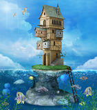 Fantasy house on a rock. In the middle of the sea Royalty Free Stock Images