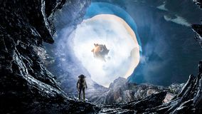 Space hole and astronaut. Mixed media stock images