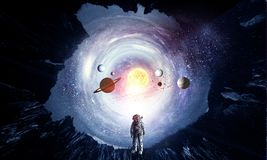 Space hole and astronaut. Mixed media royalty free stock photography