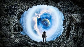 Space hole and astronaut. Mixed media. Fantasy image with astronaut in space hole. Elements of this image are furnished by NASA Stock Images