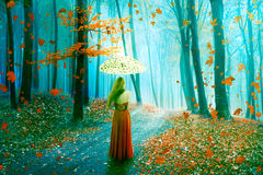 Fantasy image beautiful woman walking in forest in fairy dreamy realm Stock Images