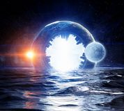 There is another world. Fantasy image with space planets and sea waters. Elements of this image are furnished by NASA Royalty Free Stock Photos