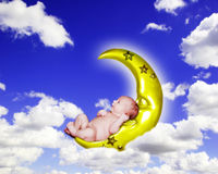 Fantasy Infant Portrait on Crescent Moon in Cloudy Sky Royalty Free Stock Image