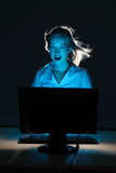 Fantasy internet experience for beautiful woman. Fantasy computer concept. Beautiful business woman sitting in front of computer screen. Happy, amazed expression royalty free stock image