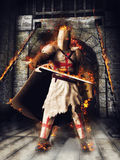 Fantasy knight on fire. Fantasy scenery with a medieval knight, caste, and fire Royalty Free Stock Photo