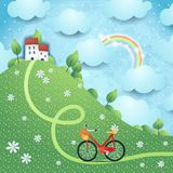 Fantasy landscape with hill, village and bike Royalty Free Stock Images