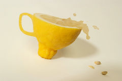 Fantasy lemon cup. Lemonade drop from the cup, fantasy cup of lemon Stock Images