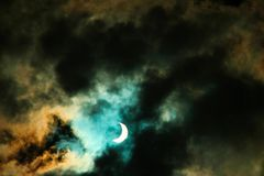 Fantasy Solar Eclipse. A fantasy like solar eclipse with colorful clouds stock photos