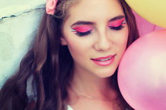 Fantasy make-up close-up. Beautiful young girl with a doll-like lashes Stock Photography
